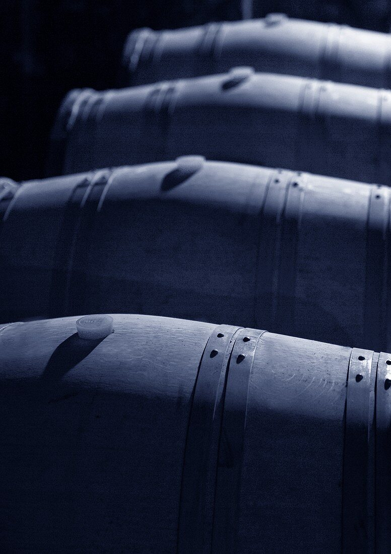 Four wooden barrels for storing wine in wine cellar