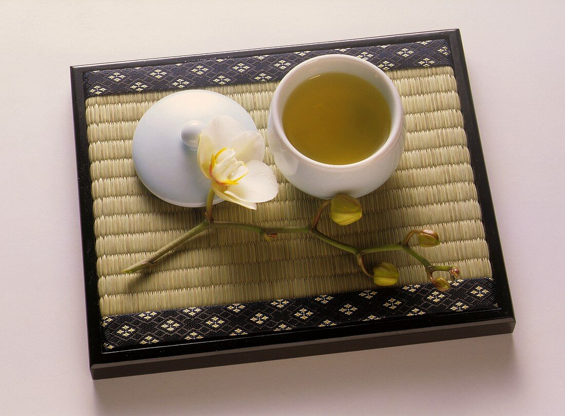 A Bowl of Green Tea on Bamboo Mat