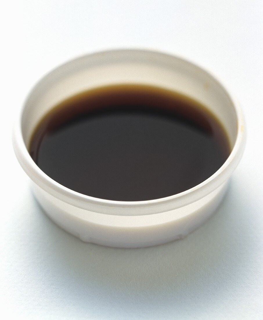 Soy Sauce in a White Plastic Container