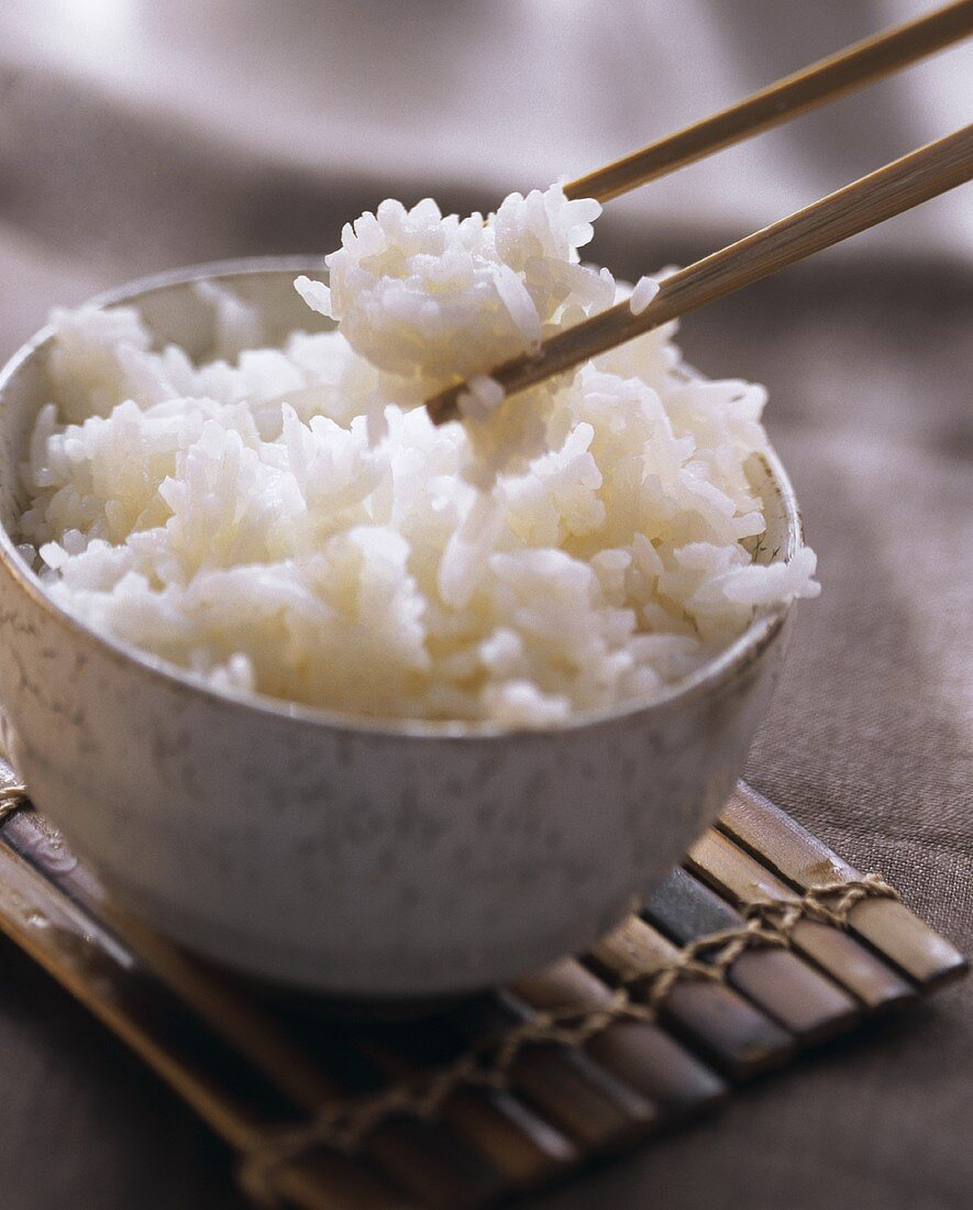 A Bowl of Cooked Rice with Chopsticks