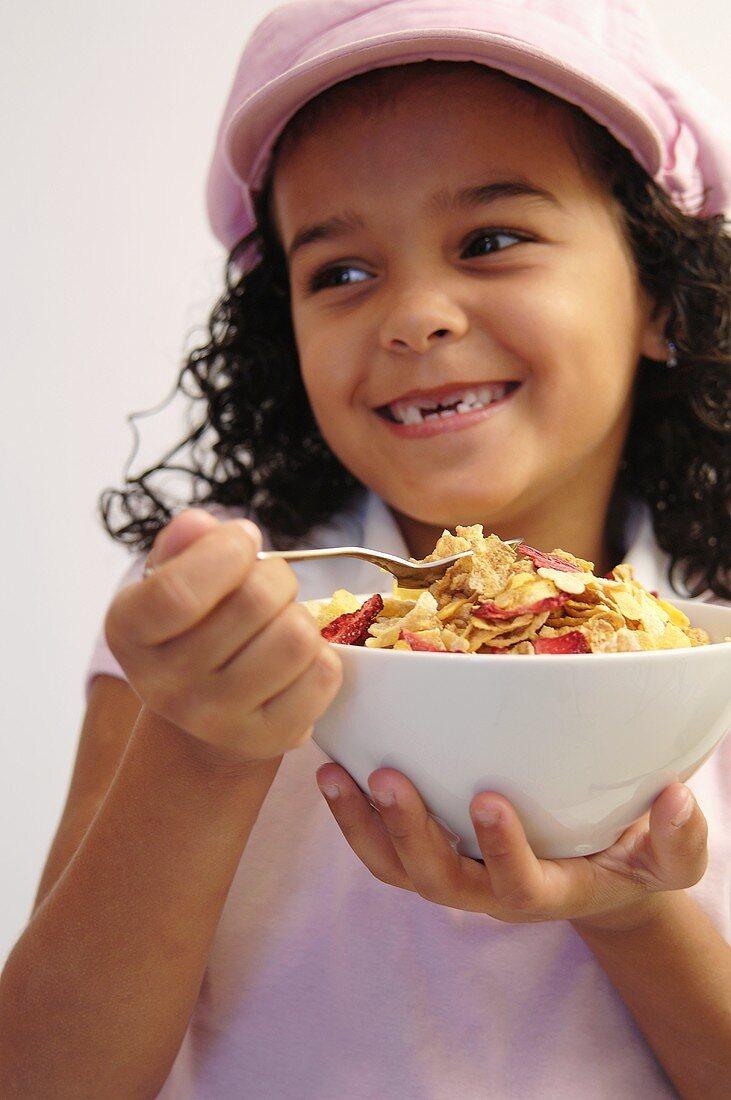 Small girl eating muesli