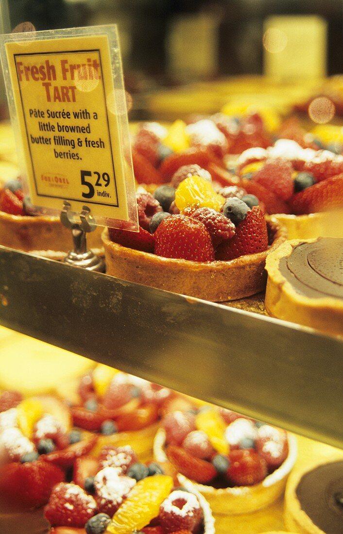 Fruit tarts in a cake shop