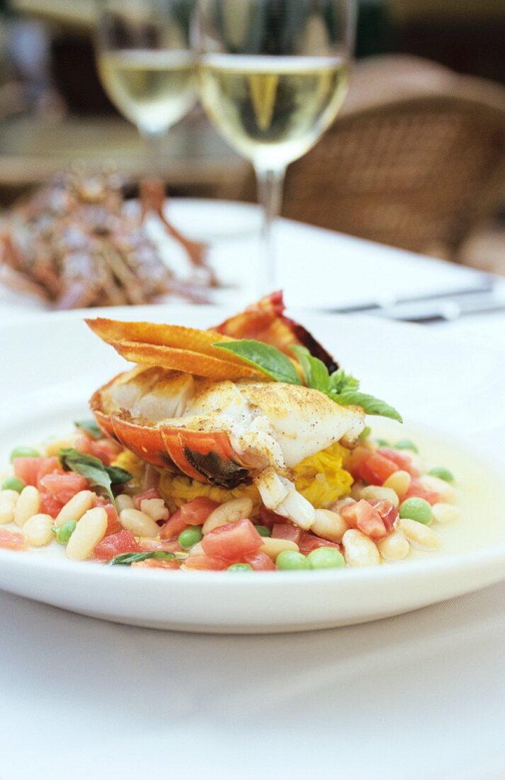Spiny lobster tail with saffron linguine on vegetables