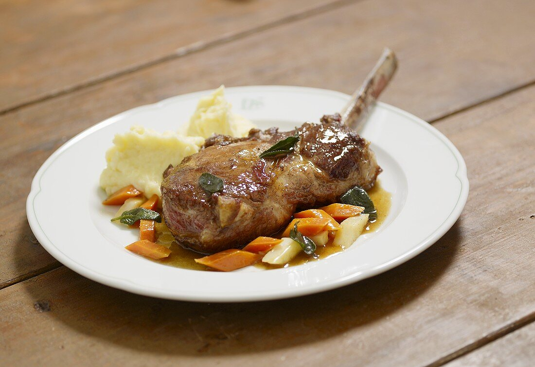 Organic pork chop with mashed potato, vegetables and sage