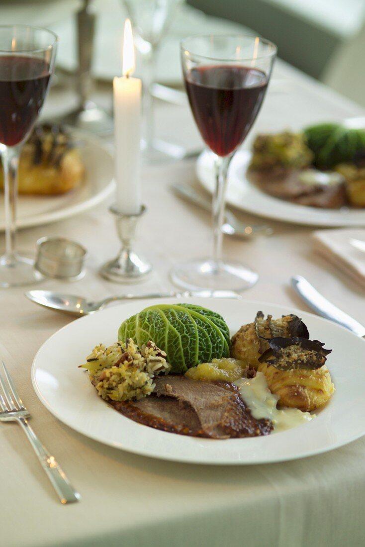 Roast goose, rice stuffing, stuffed cabbage leaf & potato fans