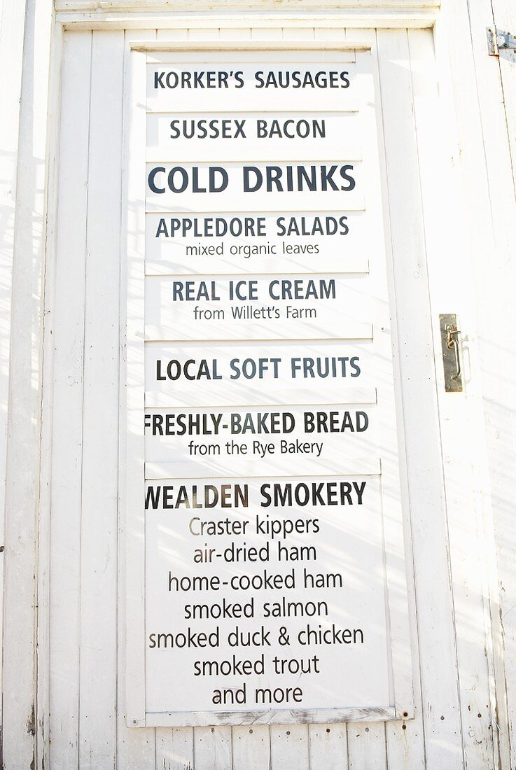 Sign on the door of a food shop in Rye, Sussex, England