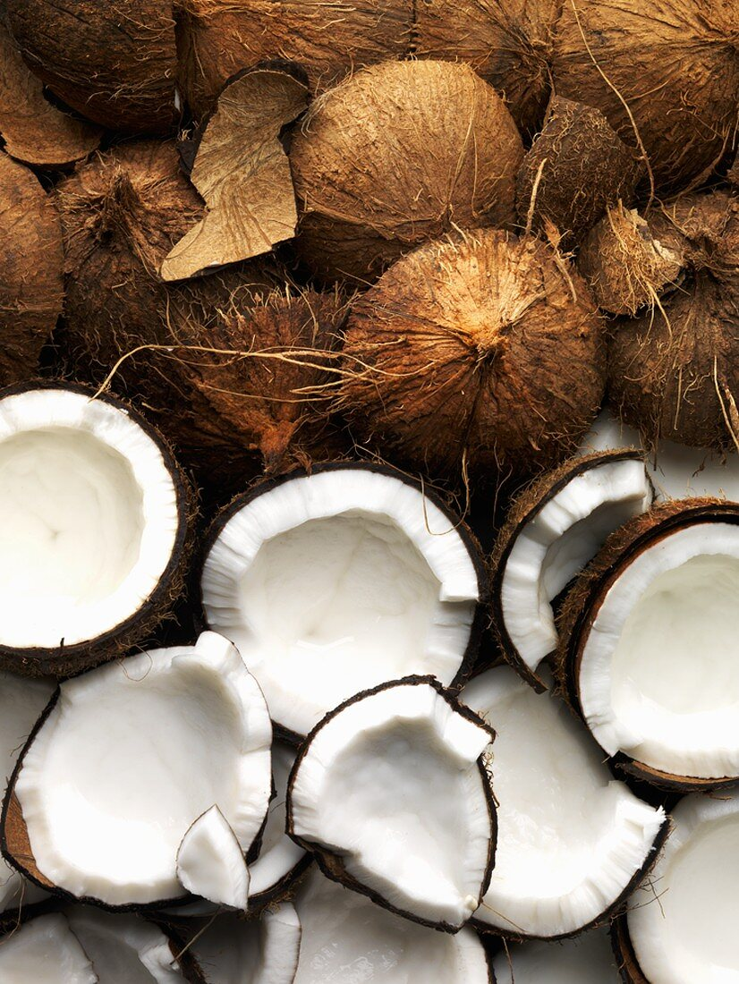 Coconuts, whole and broken open