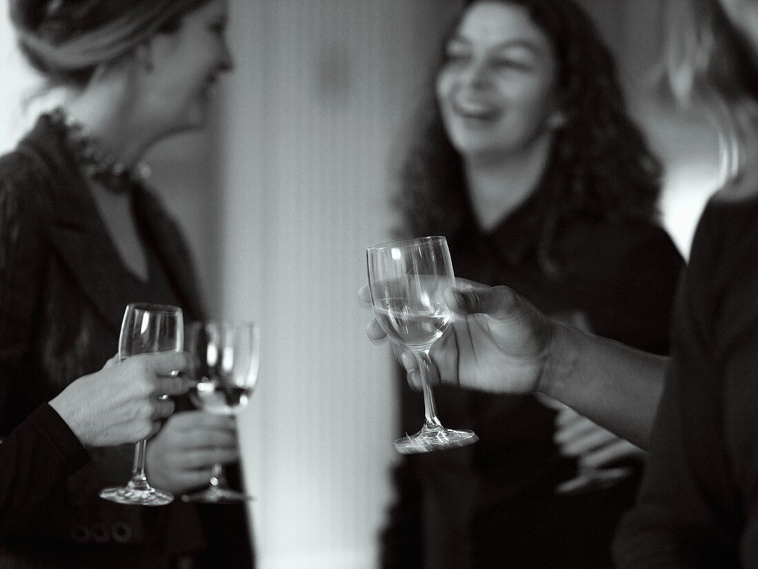 Several people with wine glasses in their hands