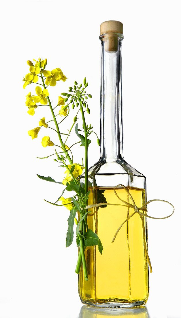 A bottle of rapeseed oil with flower