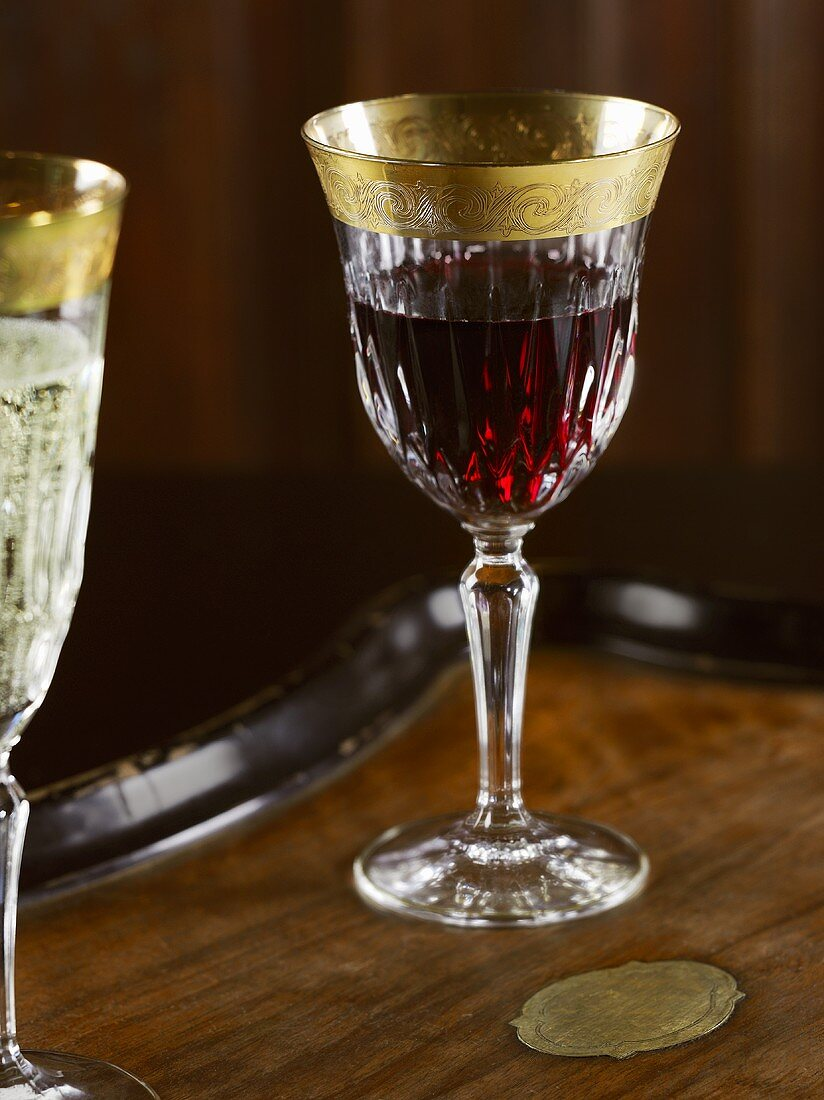 A glass of red wine and a glass of sparkling wine