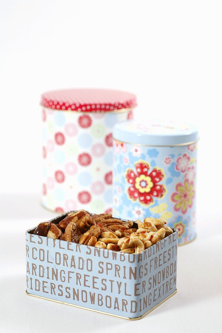 Spiced nuts in three tins