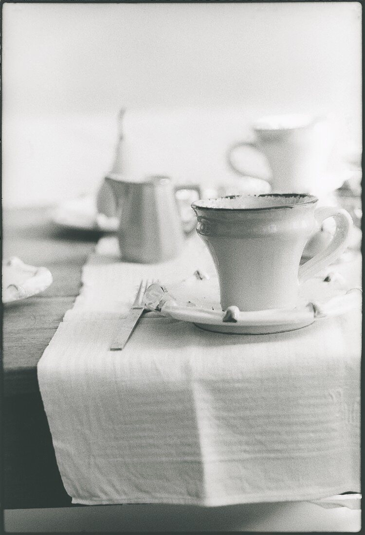 Coffee service on breakfast table (b and w photo)