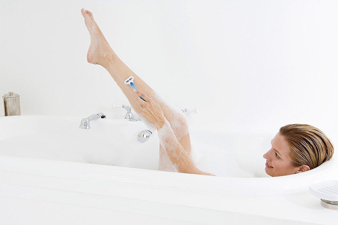A woman shaving her leg