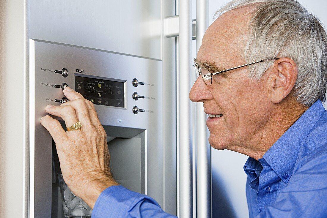 A man programming a refrigerator