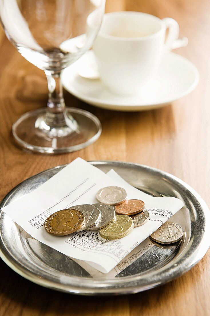 A bill and money on a table