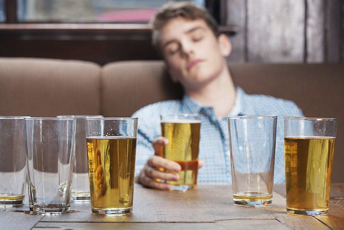 A young man asleep in a bar