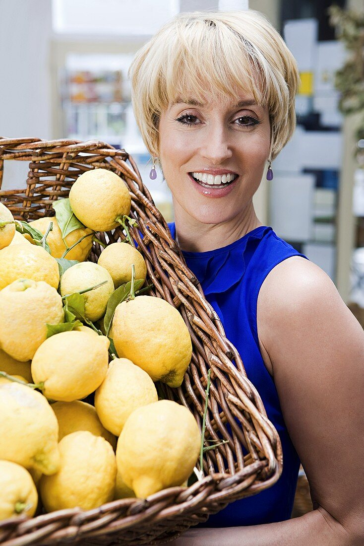 Woman in store with basket of lemons