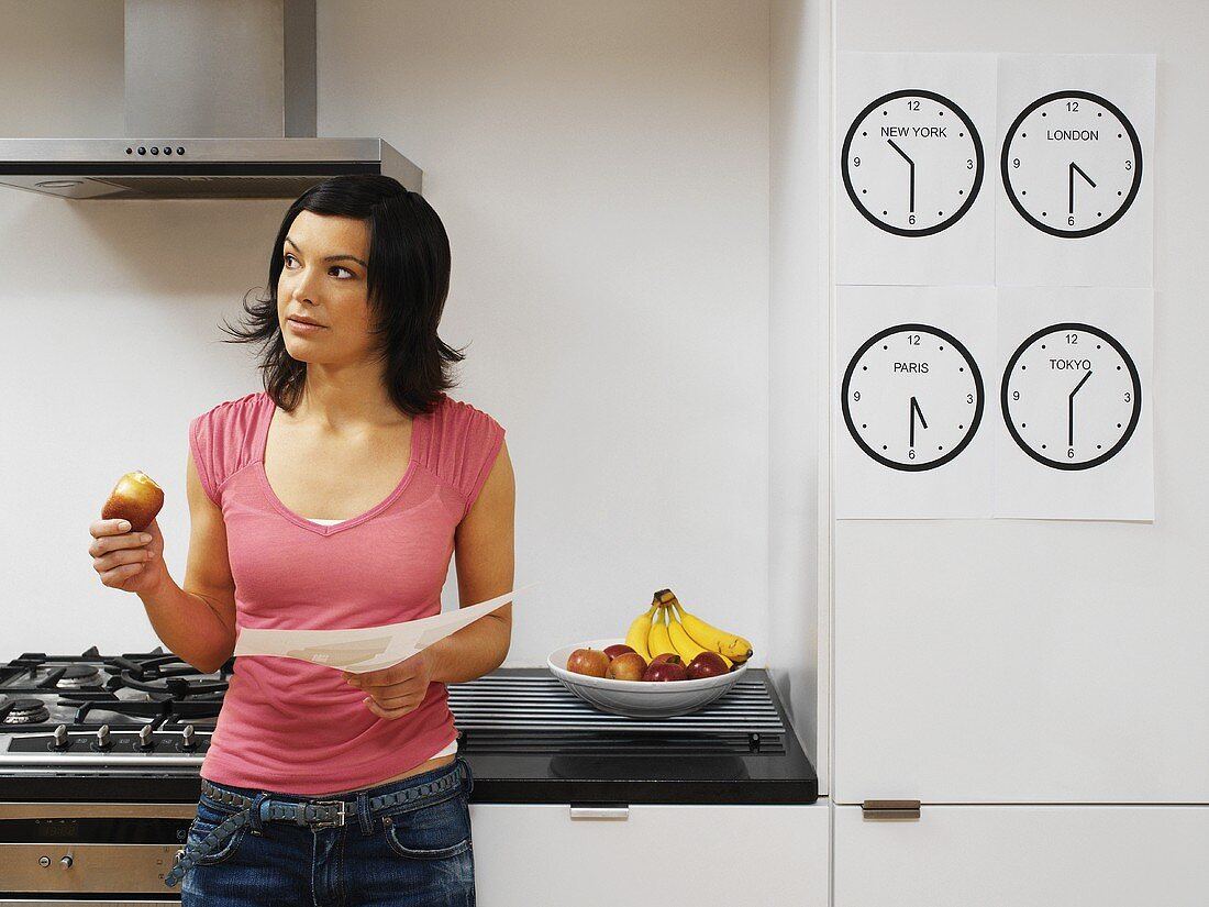 A woman standing in a kitchen