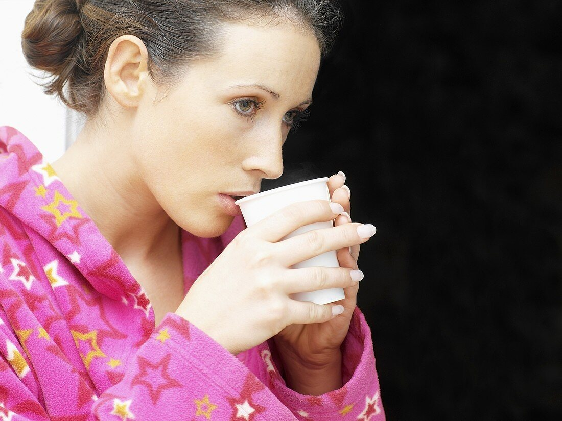 A woman with a mug of hot drink