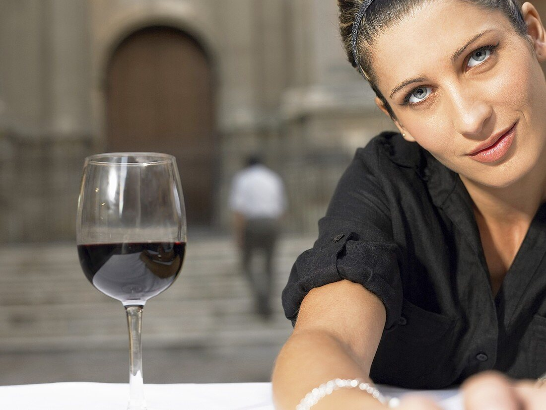 A woman with a glass of red wine