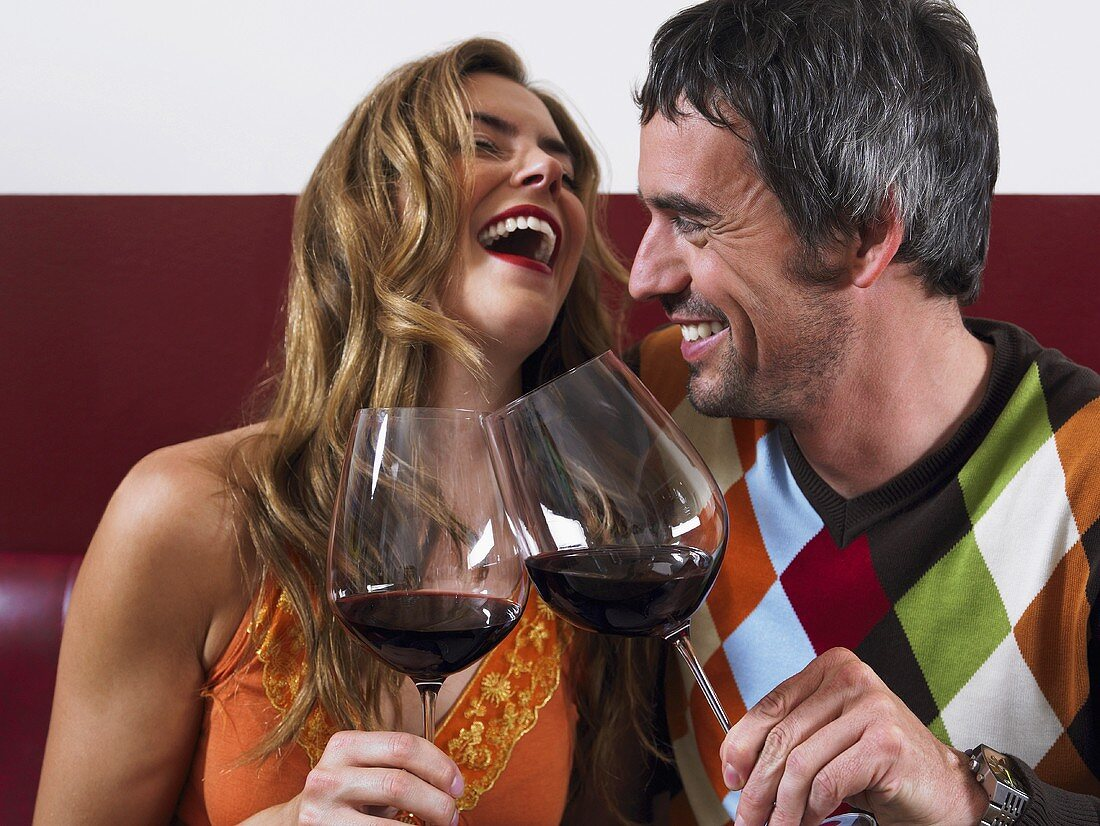 A happy couple with red wine