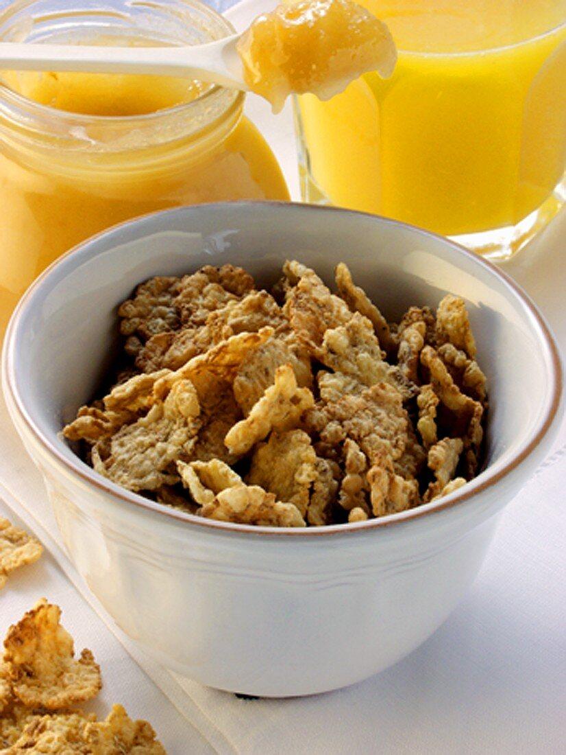 Wholemeal cornflakes, blossom honey and orange juice