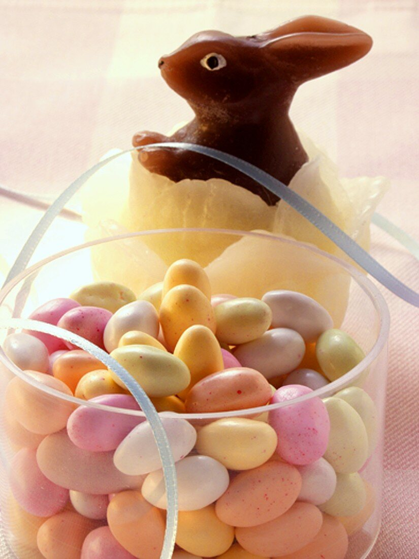 Pastel-coloured sugar eggs in acrylic box; wax Easter Bunny