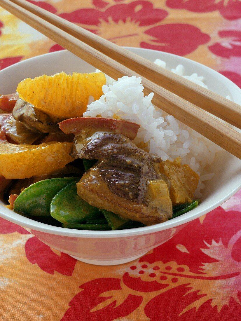 Roast duck with mangetouts, orange and rice