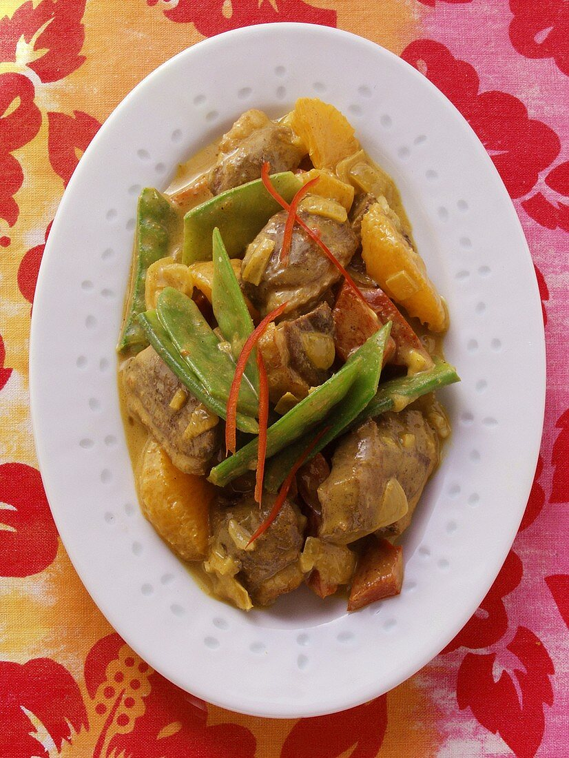 Roast duck with mangetouts, orange and peppers