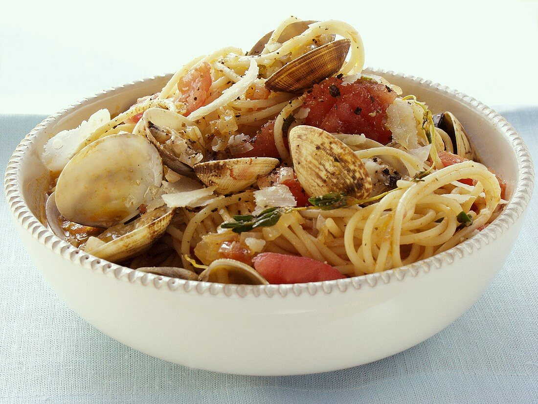 Spaghetti vongole with tomatoes and Parmesan in dish