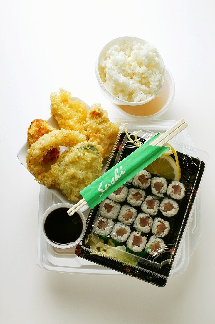 Tempura and sushi with rice and soy sauce to go