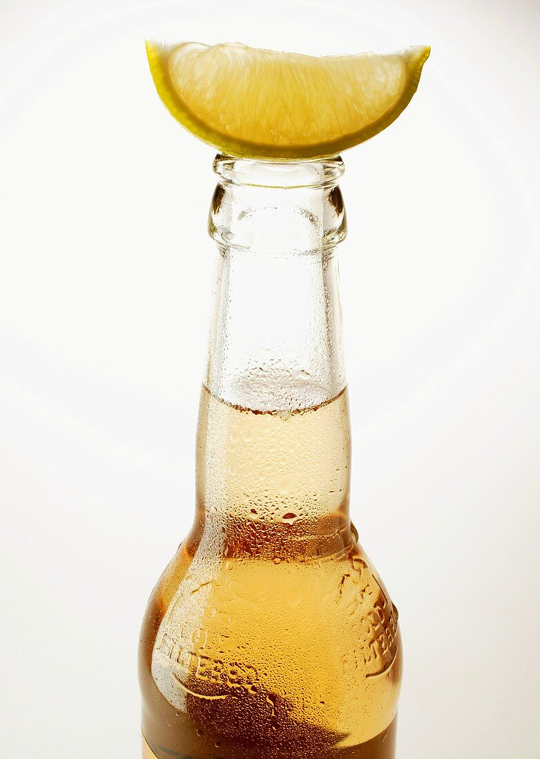 Bottle of Ginger Ale with wedge of lemon