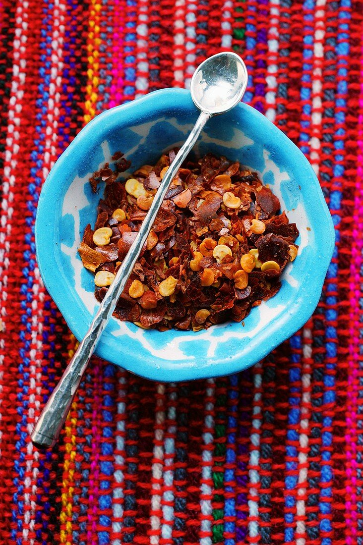 Dried chili flakes with spoon