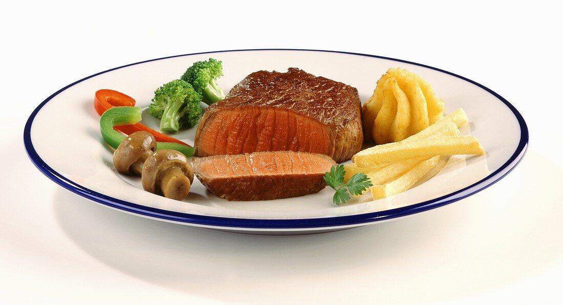 Fillet steak, medium-rare, with accompaniments