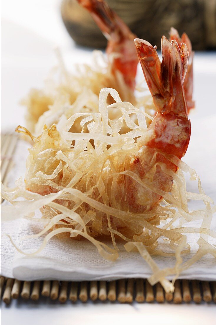 King prawns, fried in rice noodles, on bamboo mat