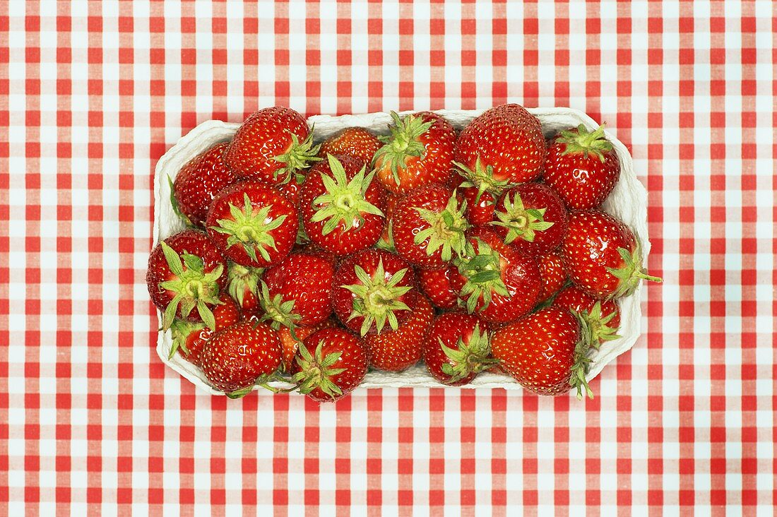 Fresh strawberries in cardboard punnet