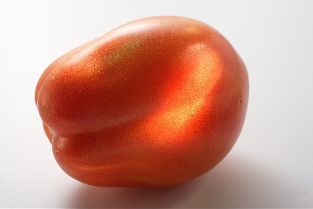A tomato (lying on its side)