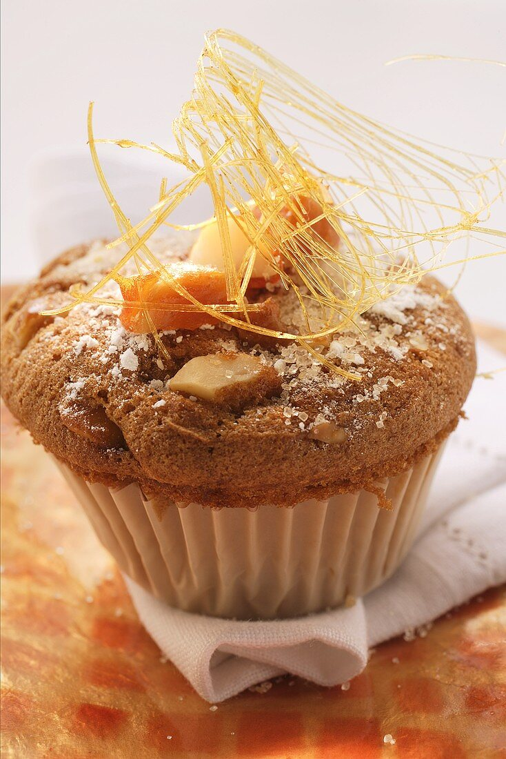 Cinnamon and macadamia muffins with sugar and caramel strands