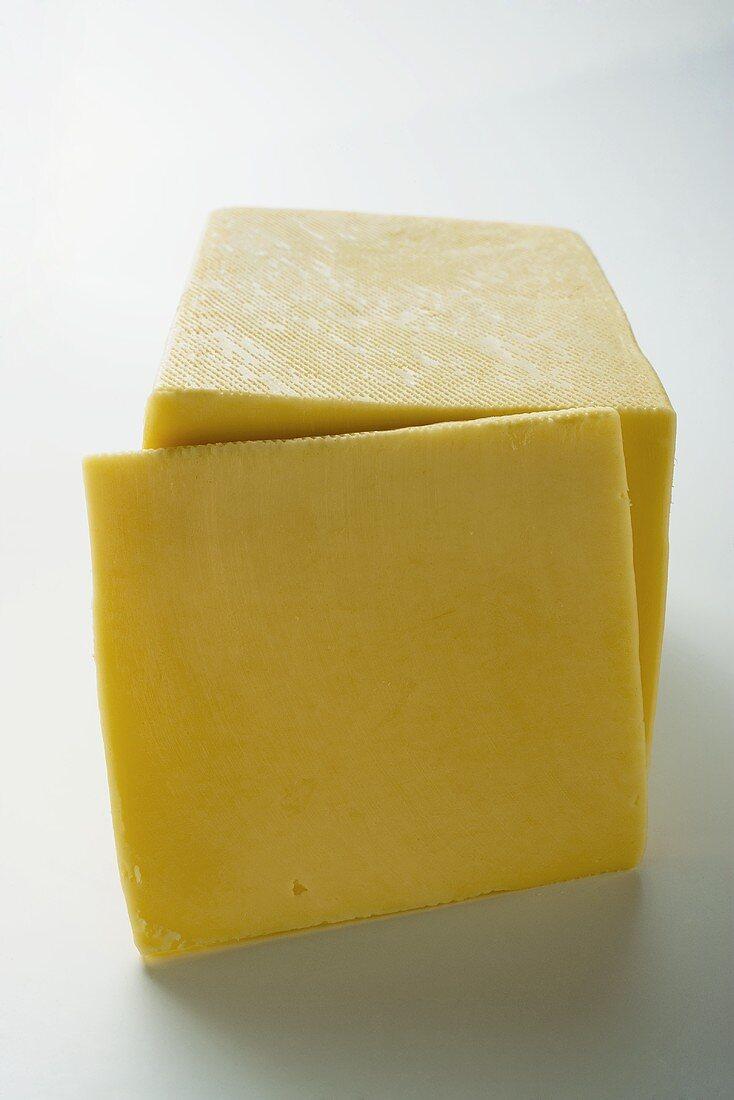 Semi-hard cheese with a slice cut