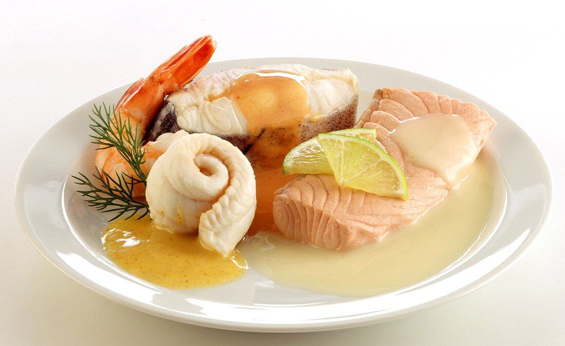 Fish platter with salmon, plaice, halibut, shrimp & sauces
