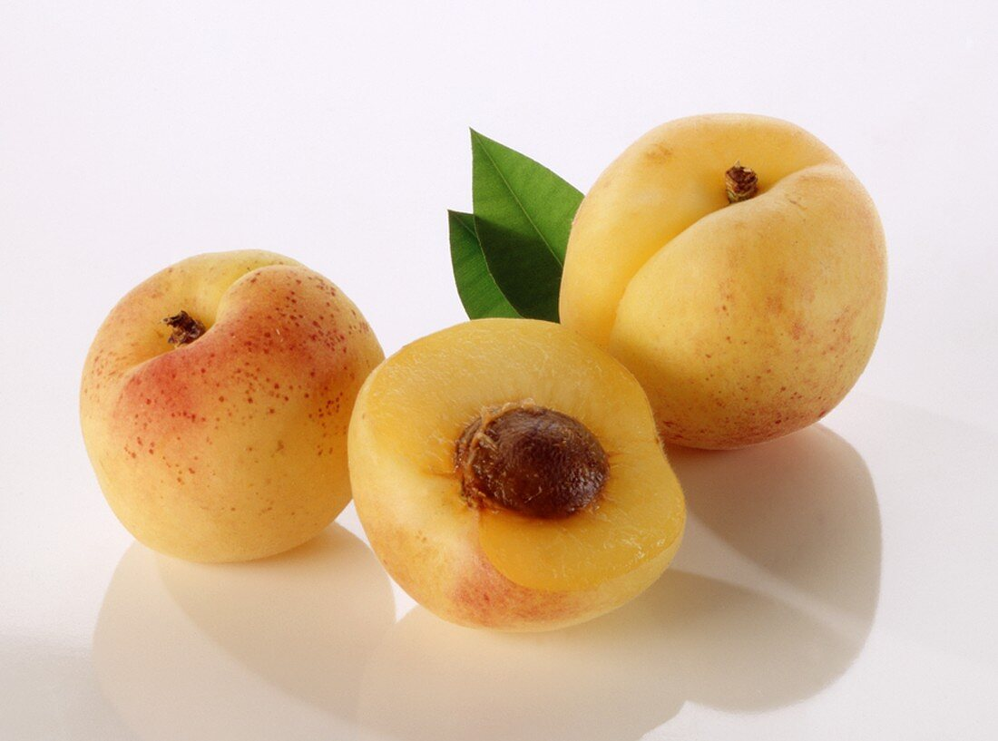 Two whole apricots and half an apricot
