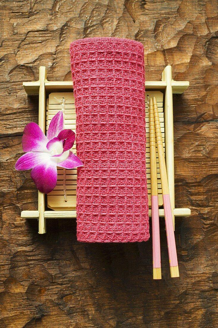 Table accessories: hand towel, chopsticks, bamboo mat & orchid