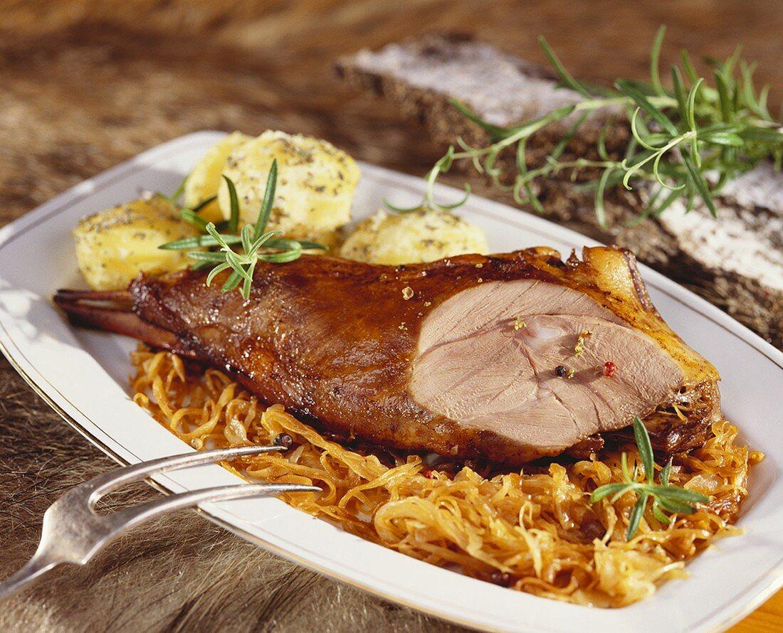 Roast leg of wild boar with sauerkraut and dumplings