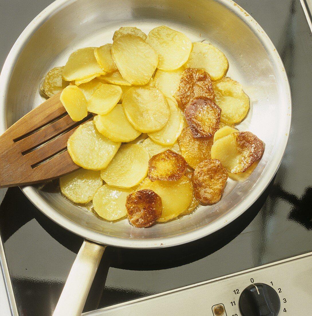 Fried potatoes (Frying potatoes in frying pan)