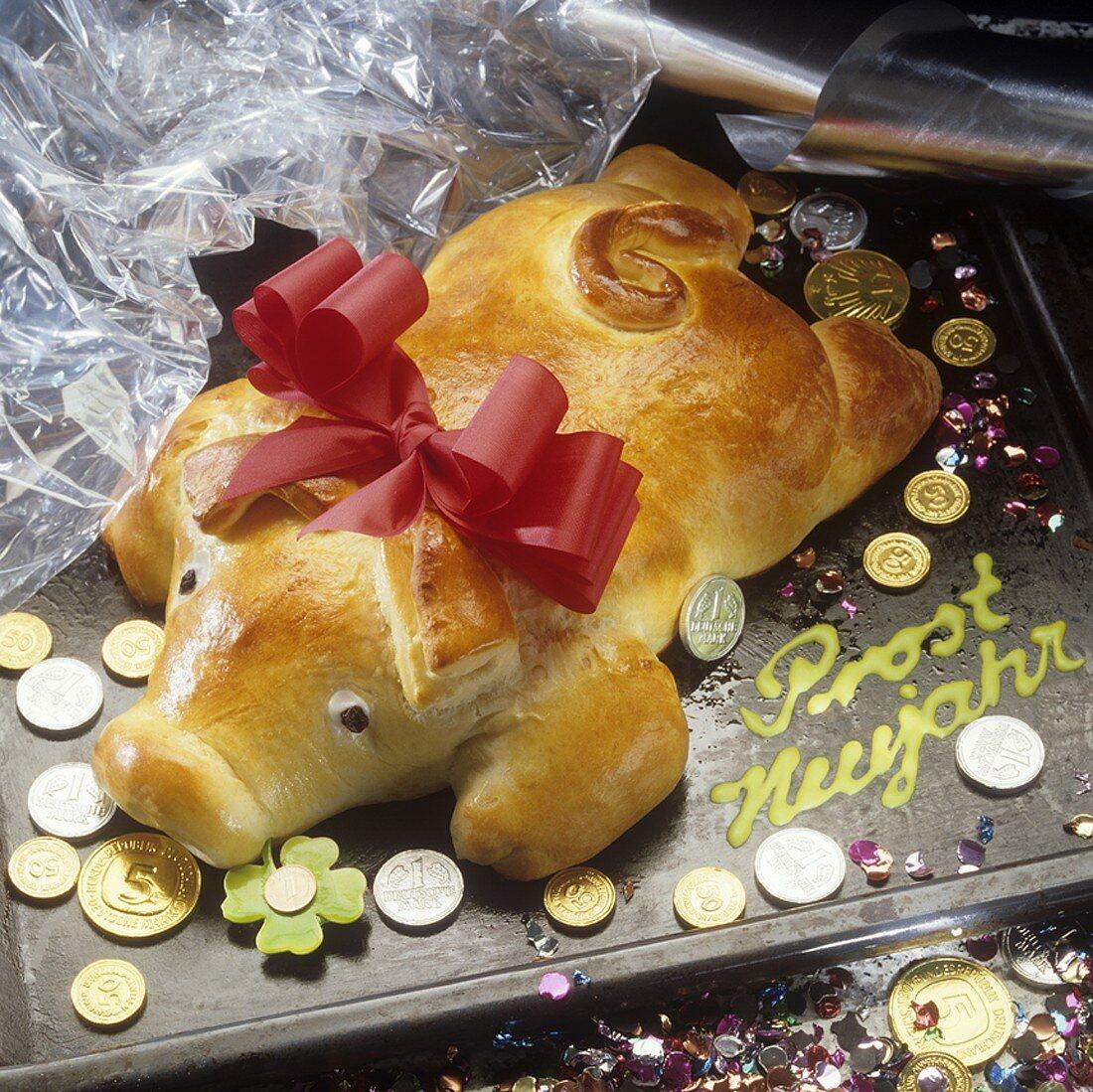 Lucky pig (bread dough), coins & 'Prost Neujahr' (New Year wish)