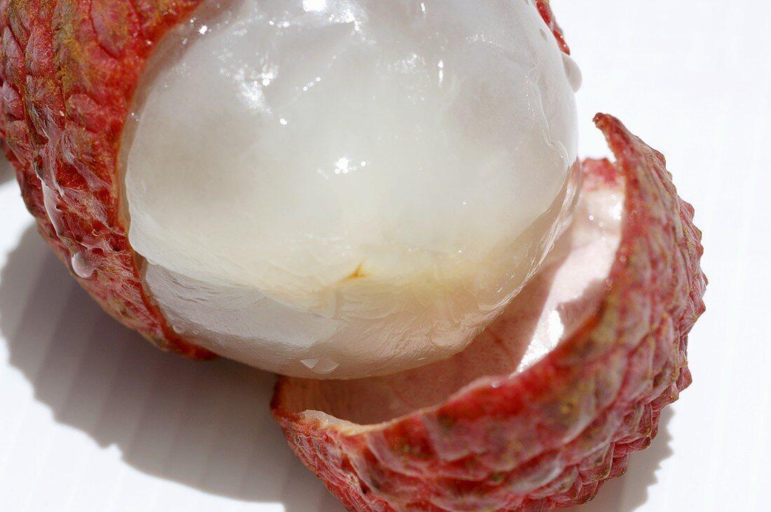 A half-peeled lychee