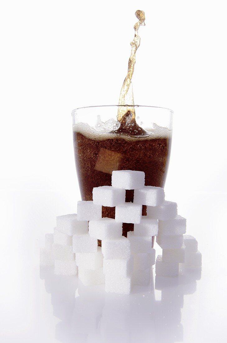 Cola & sugar cubes (picture symbolising high sugar content)