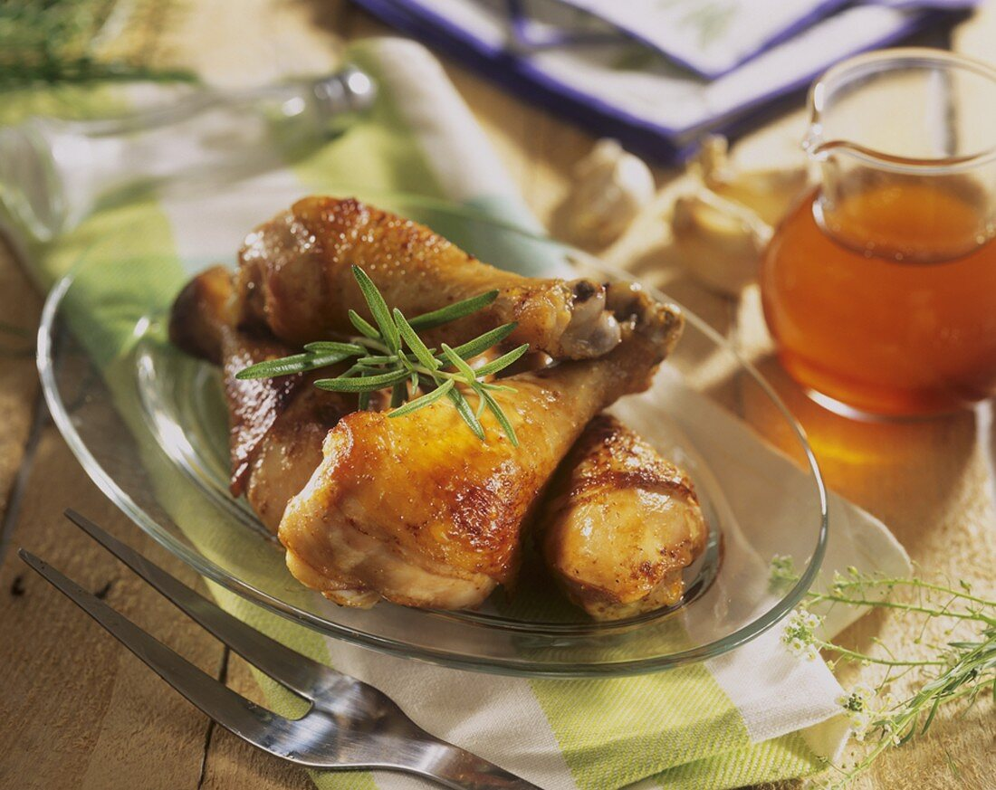 Roast chicken legs with honey and garlic marinade