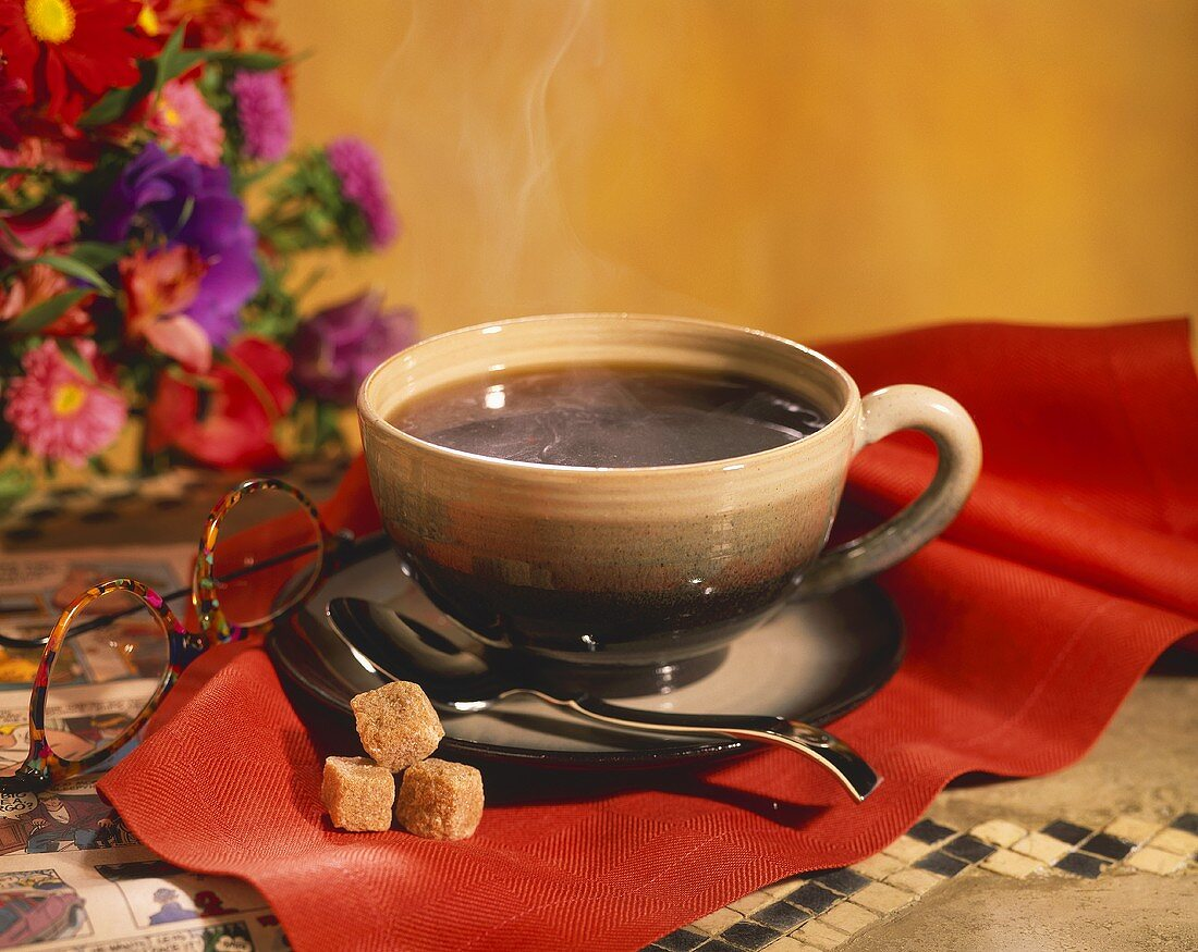 Steaming Cup of Coffee with Brown Sugar Cubes