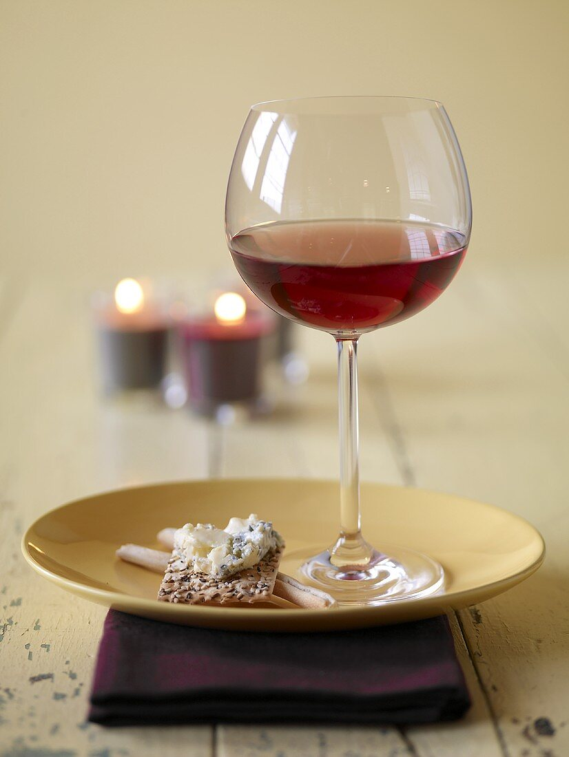 Glass of Red Wine with Cheese and Cracker